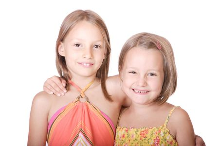 Two beautiful sisters smiling over white background photo