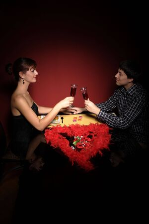 dinning: Attractive young couple with a gift in hands