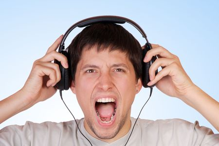 Man with headphone on his head listening music Stock Photo - 6278823