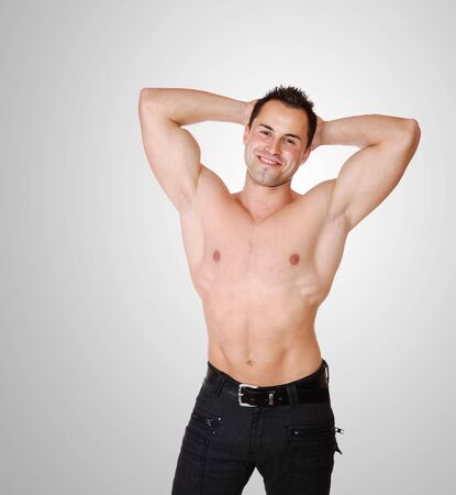 sexy muscular man: A Sexy muscular man over grey background