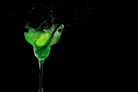 A fresh Cocktail isolated on black background   Stock Photo