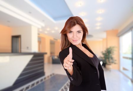 A beautiful female hotel manager in the lobby photo