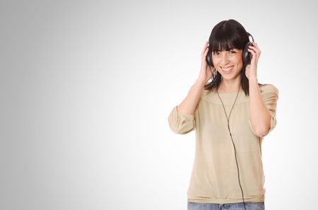 Beautiful young woman with headphones  Listening to Music Stock Photo - 6276985