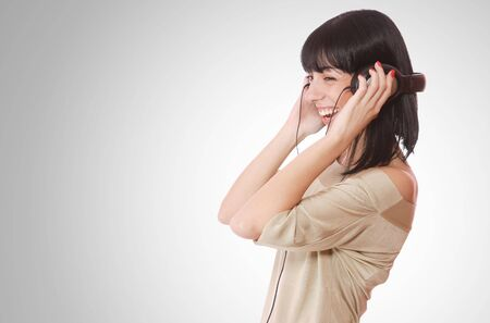 Beautiful young woman with headphones  Listening to Music Stock Photo - 6276979