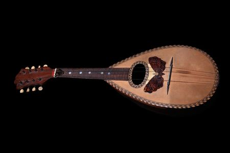 A Old mandolin isolated on black background   photo