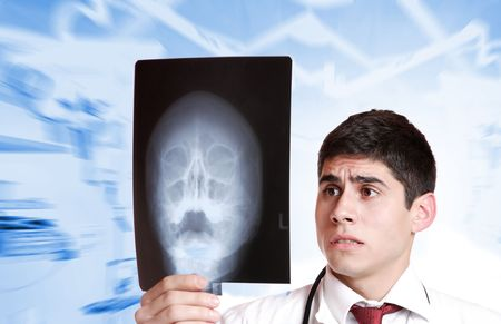 Caucasian mid adult male doctor holding up xrays.  photo