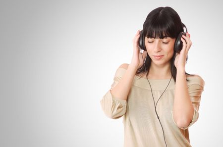 Beautiful young woman with headphones  Listening to Music Stock Photo - 6312194
