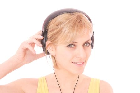 A beautiful young woman with headphones listening music   photo