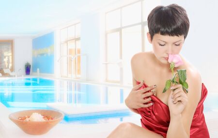 A beautiful young woman getting spa treatment photo