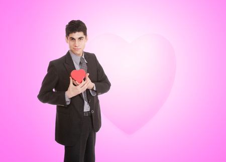 a handsome young man in suit with heart shaped gift photo