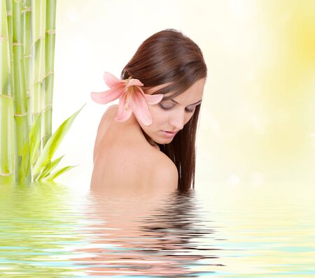 mirror on the water: Young beautiful woman with bamboo and reflection in water  Stock Photo