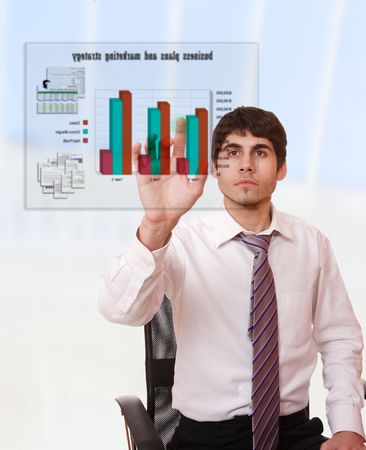 Young businessman studying a business plan on a virtual screen