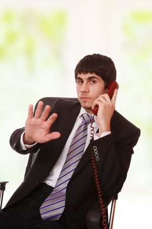 Young businessman working with phone at work photo