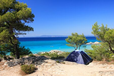 lonely tent on a sandy beach in Greece