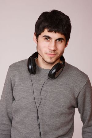 Young man listening music with headphones Stock Photo - 6312209