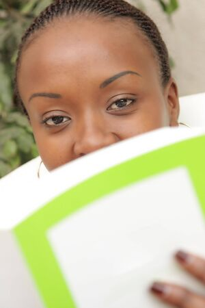 a young adult African American woman studying and working photo