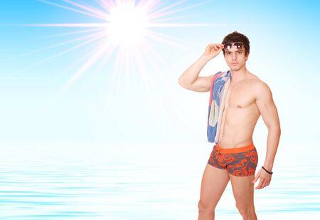 Muscular male model in swimwear     photo