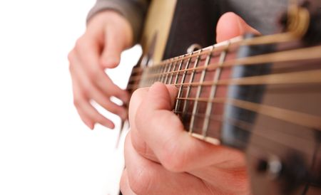 Close up of guitarist hand playing acoustic guitar  Banque d'images