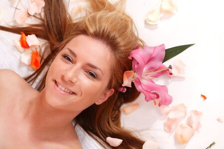Attractive woman getting spa treatment over white  photo