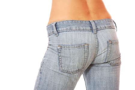Close up of a beautiful woman wearing jeans isolated on a white background     photo