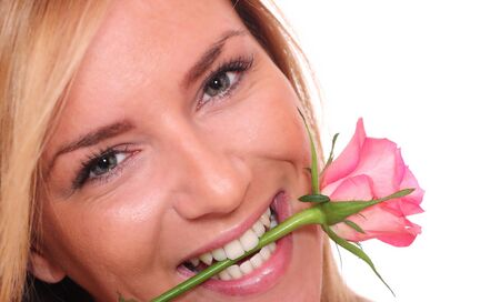 Studio portrait of sensual beautiful woman with rose on white background   photo