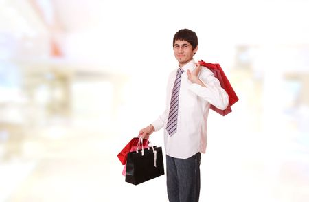 man shopping:  handsome man with shopping bags at the mall   Stock Photo