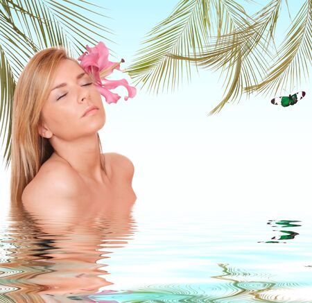 Attractive woman getting spa treatment - water reflections photo