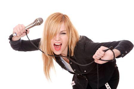 Portrait of female rock singer with microphone in hand  Standard-Bild