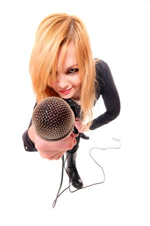 Portrait of female rock singer with microphone in hand   Фото со стока