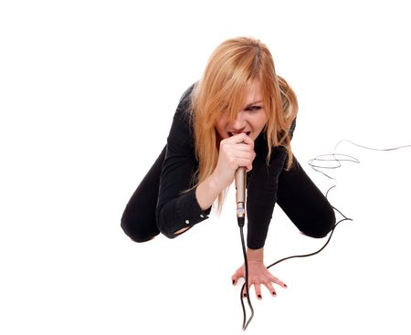 Portrait of female rock singer with microphone in hand   Stock Photo
