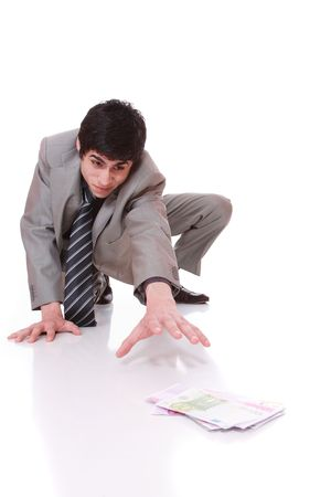 Businessman picking money on the floor over white background selective focus     photo