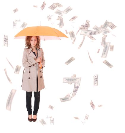 Woman holding an umbrella wearing trenchcoat with money falling around her on white   photo