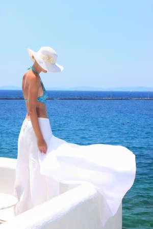 Beautiful woman enjoying the beach in Greece Stock Photo - 6799836