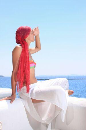 Beautiful woman enjoying the beach in Greece Stock Photo - 6799906