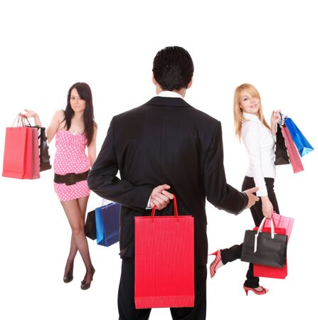 Three friends, two women and a man, going shopping with lots of shopping bags. Stock Photo - 6813139