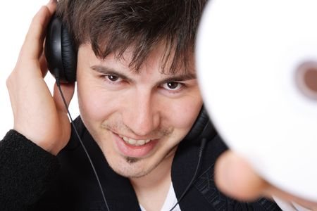 Young guy holding a compact disc isolated on white selective focus   photo
