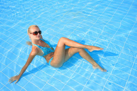 Beautiful young woman at a pool in Greece     photo