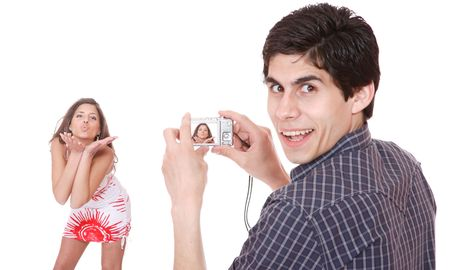 Man taking pictures of a girl photo camera in hands isolated on white background Stock Photo - 6914407