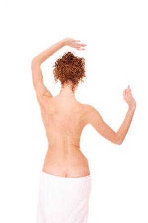 Slim woman wearing a white towel photo