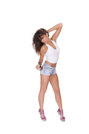 shoeless: young woman in jeans shorts studio white   Stock Photo
