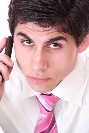 Businessman on Phone over white background   photo