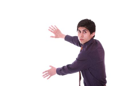 young businessman holding an imaginary screen over white Stock Photo - 7944514