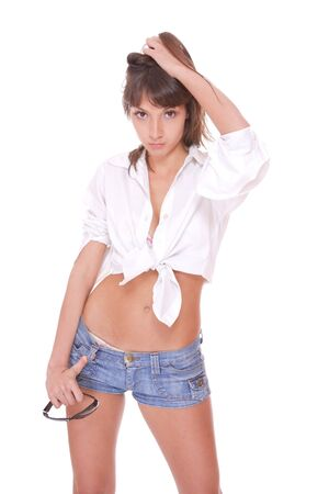girl in shorts: young woman in jeans shorts studio white   Stock Photo
