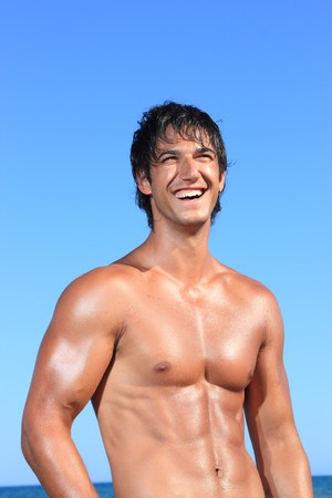sexy caucasian fit man posing in a beach Stock Photo - 7629479