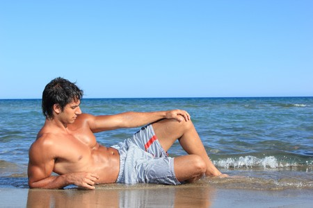 sexy caucasian fit man posing in a beach Stock Photo - 7629520