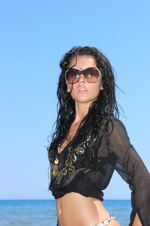 Beautiful young sexy bikini model by the sea  photo