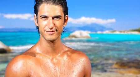 sexy caucasian fit man posing in a beach  photo