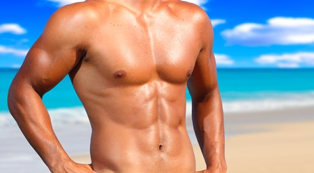 muscular male: sexy caucasian fit man posing in a beach  Stock Photo