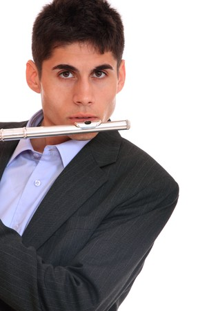 Close up of a man playing his flute.  photo