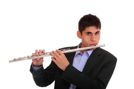 Close up of a man playing his flute.